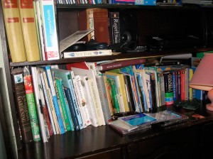 two shelves of gardening books and dictionaries