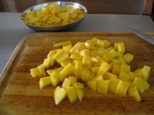 Chopped Mango on wooden chopping board