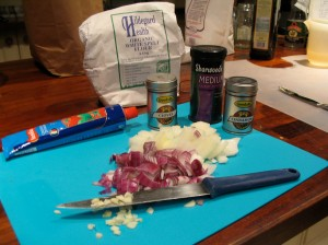 Chopped red and white onions on blue board