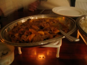 lamb curry in silver dish on heat plate