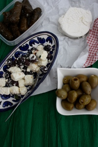 Stuffed vine-leaves, goat's cheese with honey, stuffed olives, feta and olives