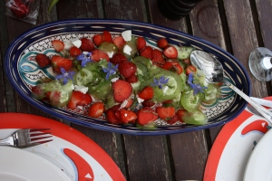 Strawberry, Cucumber and Goat's Cheese Salad on blue and white platter