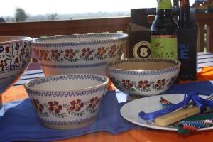 Four Nicholas Mosse bowls sitting on blue clothe