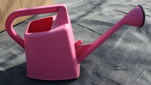 Pink watering can