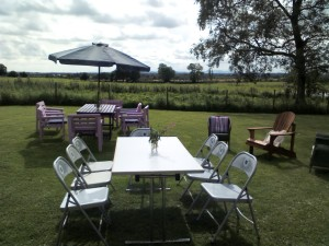 Tables and chairs set up on lawn