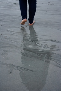 Walking barefoot on beach
