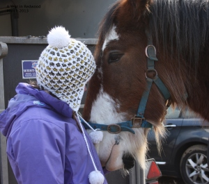 Girl whispering to her horse